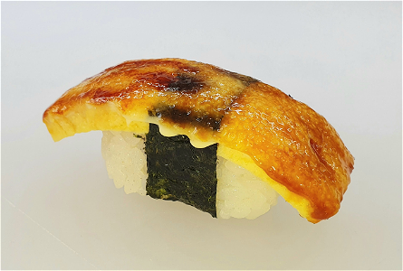Foto Flamed Sweet Tamago nigiri